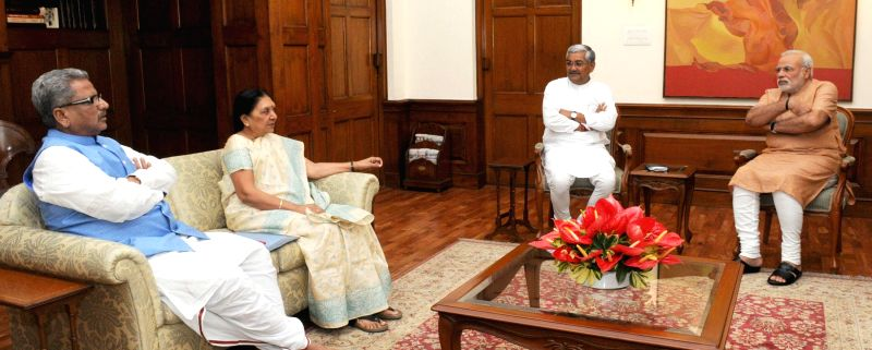 Prime Minister Narendra Modi meeting Gujarat Chief Minister Anandiben Patel  in New Delhi on Aug. 23, 2014.