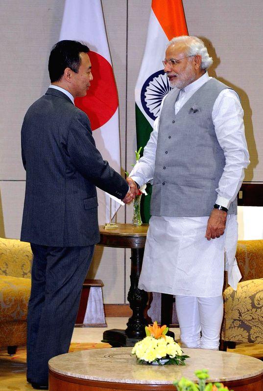 Prime Minister Narendra Modi meets a Japanese State Minister for Economy, Trade & Industry of Japan, Yosuke Takagi, at New Sachivalaya, in Gandhinagar, Gujarat on Jan 10, 2015. - Narendra Modi