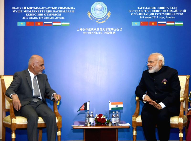 Prime Minister Narendra Modi meets Afghanistan President Dr. Mohammad Ashraf Ghani on the sidelines of the SCO Summit in Astana, Kazakhstan on June 9, 2017. - Narendra Modi