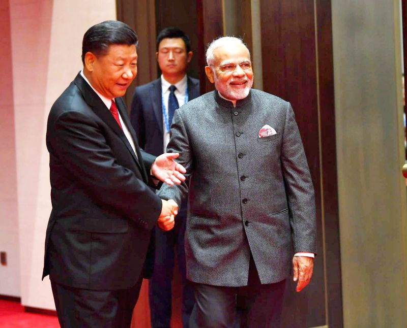 Prime Minister Narendra Modi meets Chinese President Xi Jinping, on the sidelines of the Shanghai Cooperation Organisation (SCO) Summit in Qingdao, China on June 9, 2018. - Narendra Modi