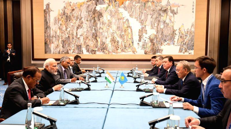 Prime Minister Narendra Modi meets Kazakhstan President Nursultan Nazarbayev on the sidelines of the Shanghai Cooperation Organisation (SCO) Summit in Qingdao, China on June 10, 2018. - Narendra Modi