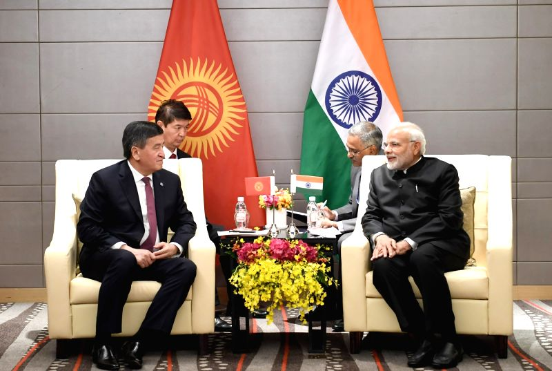 Prime Minister Narendra Modi meets Kyrgyzstan President Sooronbay Jeenbekov on the sidelines of the Shanghai Cooperation Organisation (SCO) Summit, in Qingdao, China on June 10, 2018. - Narendra Modi