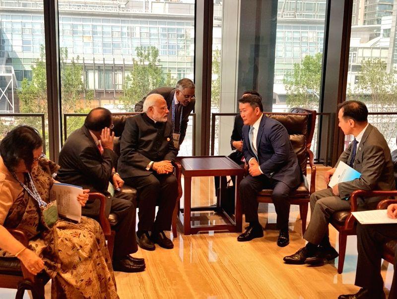 Prime Minister Narendra Modi meets Mongolian President Battulga Khaltmaa on the sidelines of the Shanghai Cooperation Organisation (SCO) Summit in Qingdao, China on June 10, 2018. - Narendra Modi