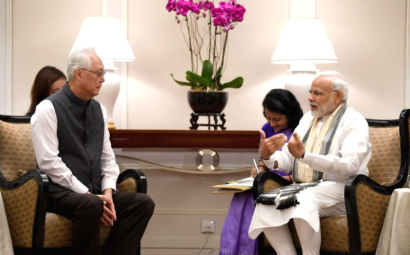 Prime Minister Narendra Modi meets Singapore's Emeritus Senior Minister Goh Chok Tong, in Singapore on June 2, 2018. - Narendra Modi