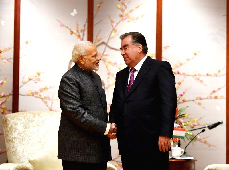 Prime Minister Narendra Modi meets Tajikistan President Emomali Rahmon on the sidelines of the Shanghai Cooperation Organisation (SCO) Summit in Qingdao, China on June 9, 2018. - Narendra Modi