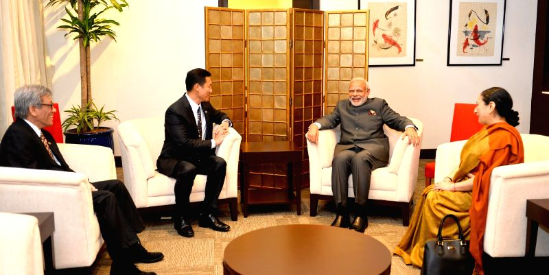 Prime Minister Narendra Modi meets the Foreign Affairs Minister of Singapore, Dr. Vivian Balakrishnan, in Singapore on Nov 23, 2015. - Narendra Modi