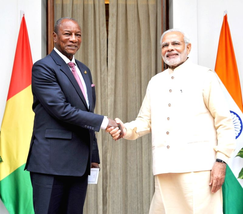 Prime Minister Narendra Modi meets the Guinea President Alpha Conde during the 3rd India Africa Forum Summit, in New Delhi on Oct 28, 2015. - Narendra Modi