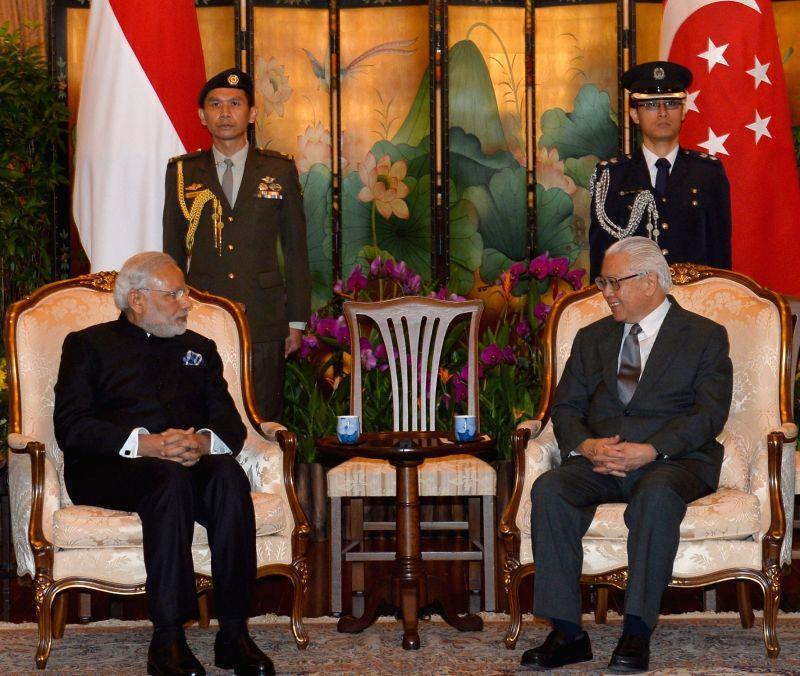 Prime Minister Narendra Modi meets the President of Singapore Tony Tan Keng Yam, in Istana, Singapore on Nov 24, 2015. - Narendra Modi
