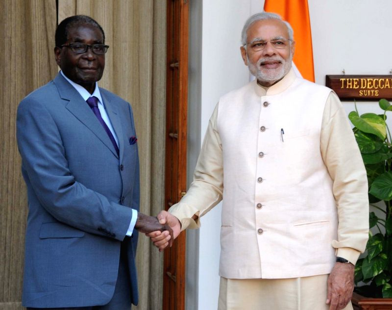 Prime Minister Narendra Modi meets the Zimbabwe President Robert Gabriel Mugabe during the 3rd India Africa Forum Summit, in New Delhi on Oct 28, 2015. - Narendra Modi