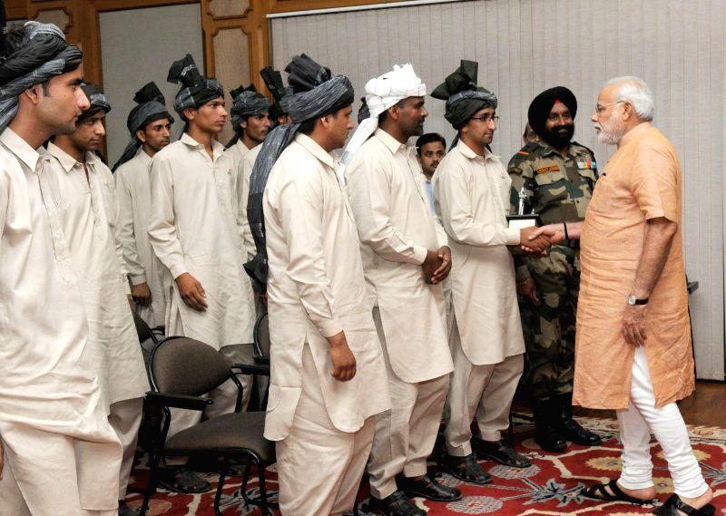 Prime Minister, Narendra Modi meets youth delegation of Gujjar Bakkarwal communities from Jammu and Kashmir, in New Delhi on Aug. 23, 2014.