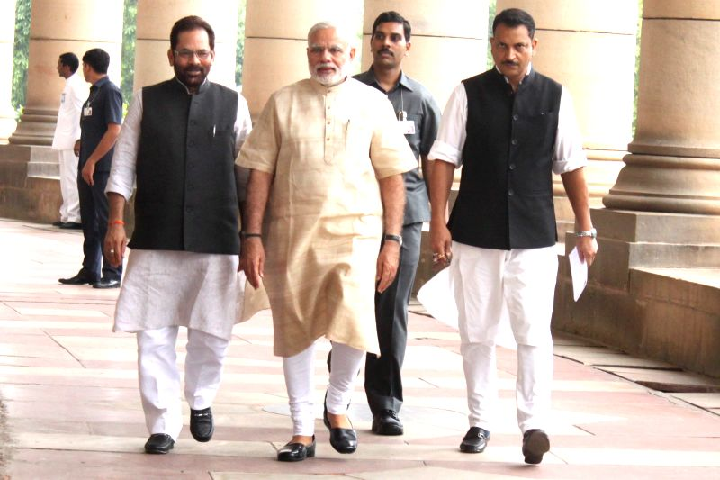 Prime Minister Narendra Modi, Minister of State for Parliamentary Affairs Mukhtar Abbas Naqvi and Union Minister of State for Skill Development and Entrepreneurship (Independent Charge) ... - Narendra Modi