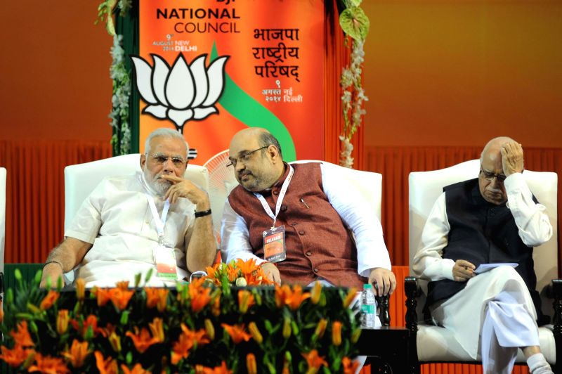 Prime Minister Narendra Modi, Newly appointed BJP President Amit Shah and Senior BJP leader L K Advani at the BJP National Council meeting in New Delhi on Aug 9, 2014. - Narendra Modi and L K Advani