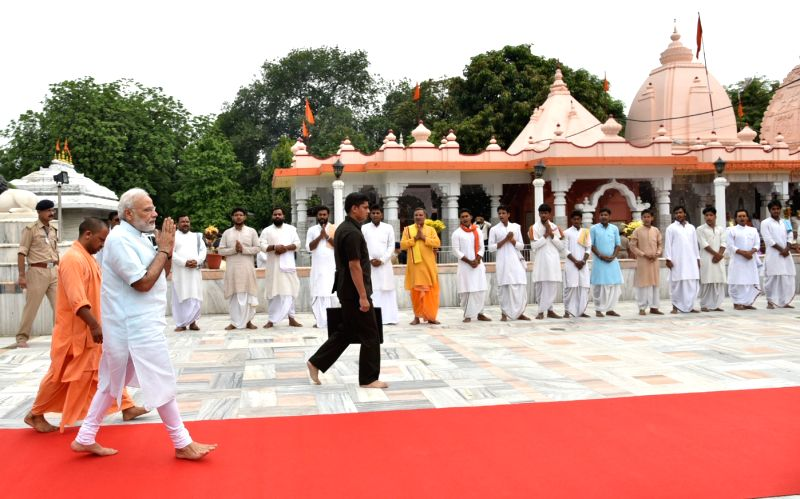 Prime Minister Narendra Modi offers prayers at Gorakhnath Mandir, in Gorakhpur, Uttar Pradesh on July 22, 2016. The Governor of Uttar Pradesh Ram Naik and the Union Minister for Chemicals ... - Narendra Modi and Affairs Ananth Kumar