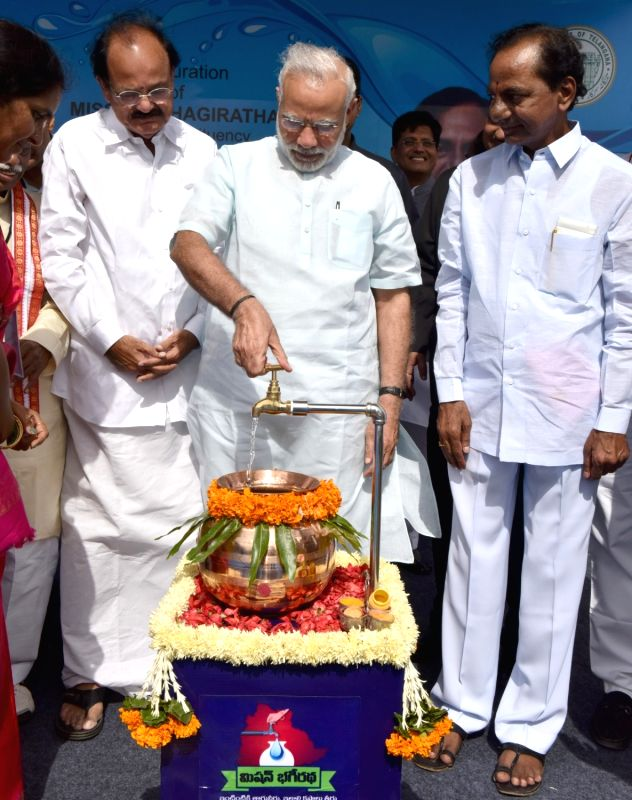 Prime Minister Narendra Modi opens the first tap of Mission Bhagiratha in Telangana on August 7, 2016. Also seen Union Minister for Urban Development, Housing and Urban Poverty Alleviation ... - Narendra Modi, M. Venkaiah Naidu and K. Chandrasekhar Rao