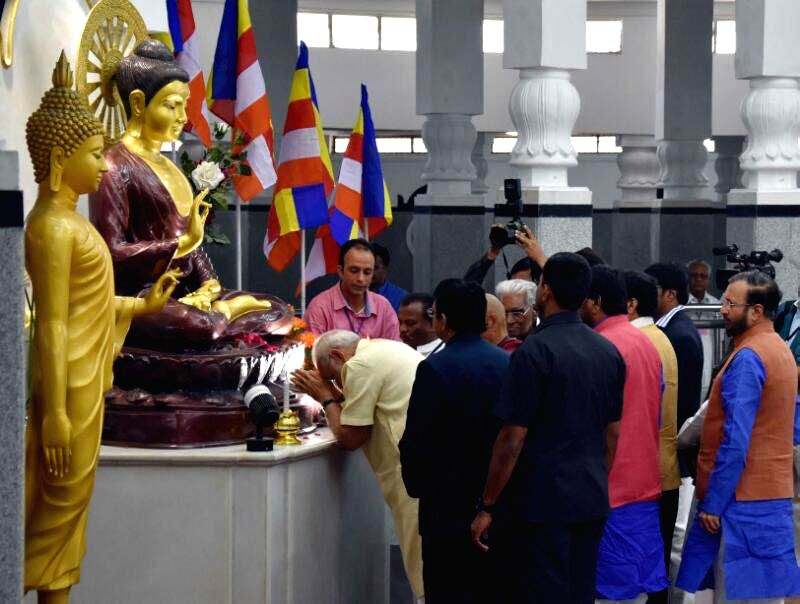 Prime Minister Narendra Modi paid homage to Babasaheb Ambedkar on his 126th birth anniversary at the historic Deekshabhoomi, in Nagpur on Friday. He was accompanied by Union Ministers Nitin Gadkari, ... - Narendra Modi and Nitin Gadkari