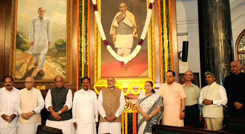 Prime Minister Narendra Modi paying floral tribute at the portrait of Sardar Vallabhbhai Patel, on his Birth Anniversary, at Parliament House, in New Delhi on October 31, 2015. (Photo: ... - Narendra Modi and Sumitra Mahajan