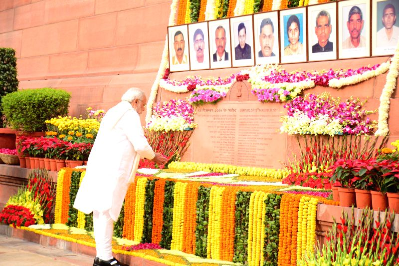 Prime Minister Narendra Modi paying homage to Parliament attack martyrs on its 13th anniversary in New Delhi on Dec. 13, 2014. - Narendra Modi