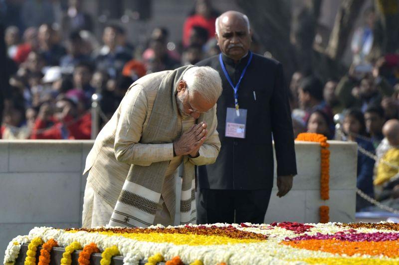 Prime Minister Narendra Modi paying tributes at the samadhi of Mahatma Gandhi on his death anniversary in New Delhi on Jan. 30, 2018. - Narendra Modi