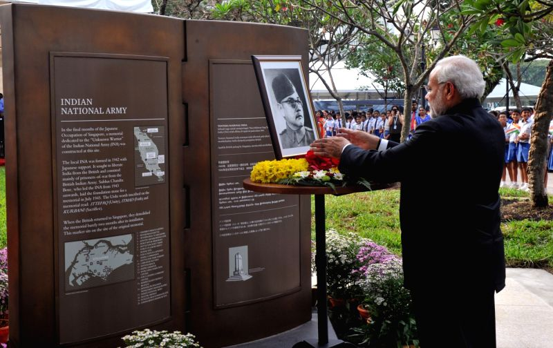 Prime Minister Narendra Modi pays floral tribute to Netaji Subhas Chandra Bose, at the Indian National Army Memorial Marker, in Singapore on Nov 24, 2015. - Narendra Modi