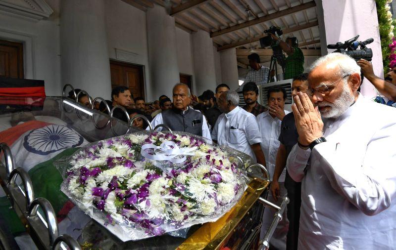 Prime Minister Narendra Modi pays homage to the late DMK President M. Karunanidhi at Rajaji Hall, in Chennai on Aug 8, 2018. - Narendra Modi