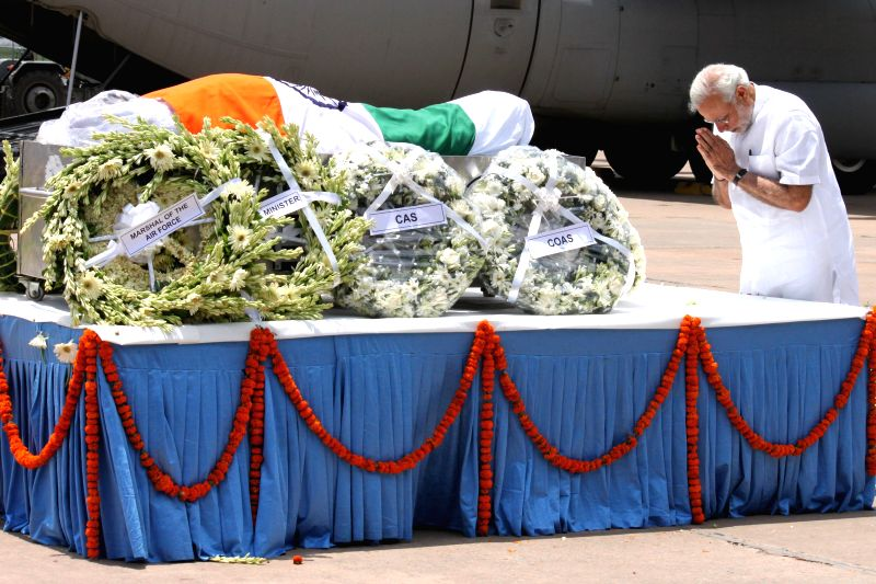 Prime Minister Narendra Modi pays tribute to former president APJ Abdul Kalam at Palam technical area of IGI Airport in New Delhi, on July 28, 2015.The former president died on Monday in a ...