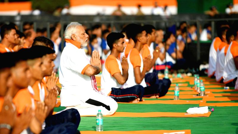 Prime Minister Narendra Modi practices yoga asanas (postures)