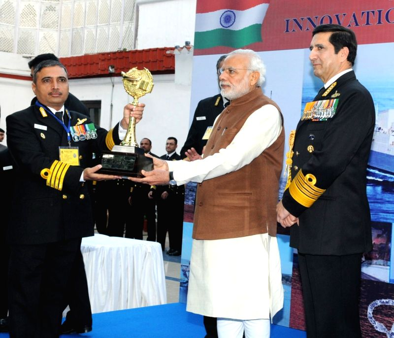 Prime Minister Narendra Modi presents Innovation trophies to awardees, during the 'At Home' reception, organised by the Chief of Naval Staff, Admiral R K Dhowan, on the occasion of Navy ... - Narendra Modi