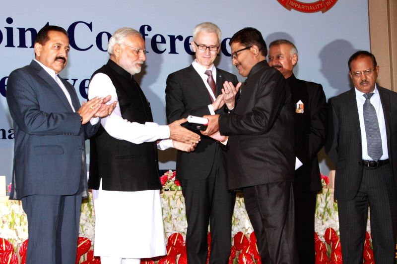 Prime Minister Narendra Modi presents police medals at the Sixth Global Focal Point Conference on Asset Recovery, in New Delhi on Nov 18, 2015. Also seen INTERPOL Secretary General Jurgen ... - Narendra Modi, Jitendra Singh and Sinha