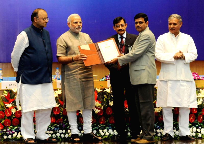 Prime Minister Narendra Modi presents Special Award for Strategic Contribution 2013 to K. Ravi Sankar and his team at the DRDO Awards presentation ceremony  in New Delhi on August 20, 2014. Also seen - Narendra Modi, Arun Jaitley and Inderjit Singh