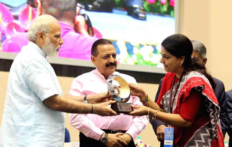 Prime Minister Narendra Modi presents the awards for Excellence in Implementation of Priority Programmes to District Collector Nizamabad IAS Yugeeta Rana for best performance of National ... - Narendra Modi and Jitendra Singh