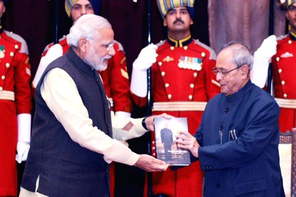 Prime Minister Narendra Modi presents the first copy of the released books to the President Pranab Mukherjee, at Rashtrapati Bhavan, in New Delhi on Dec 11, 2015. - Narendra Modi and Pranab Mukherjee