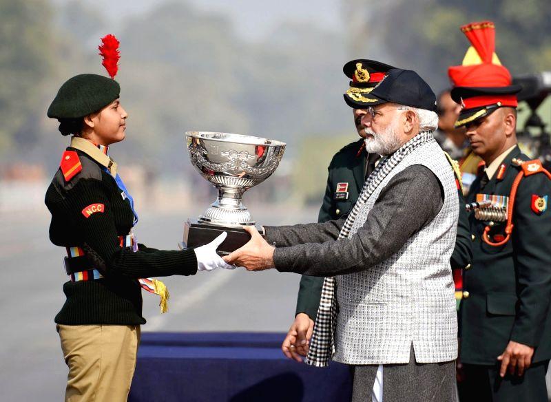 Prime Minister Narendra Modi presents trophy to the winner at the NCC Rally in New Delhi on Jan 28, 2018. - Narendra Modi