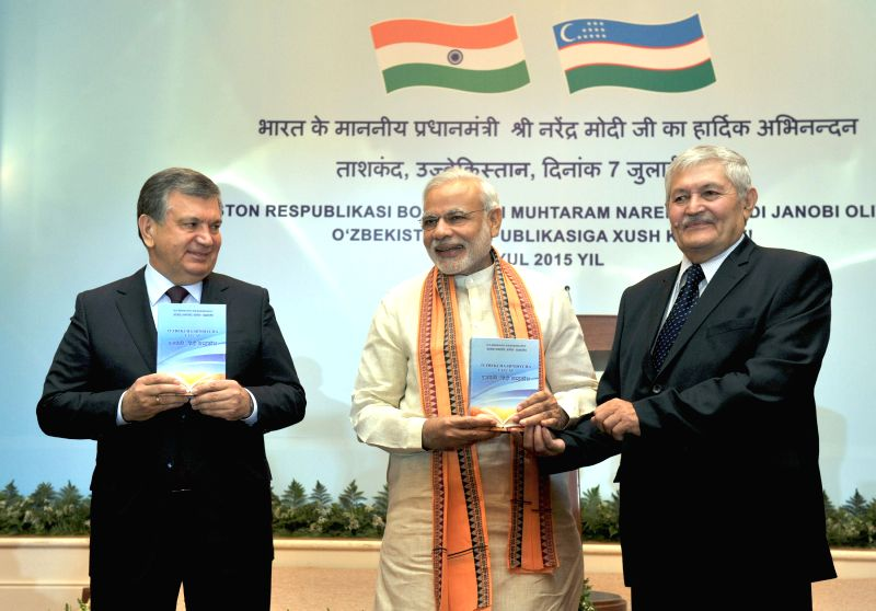 Prime Minister Narendra Modi release the first Uzbek-Hindi dictionary along with the Prime Minister of Uzbekistan Shavkat Miromonovich Mirziyoyev and the Indologist Rakhmatov in Tashkent, ... - Narendra Modi