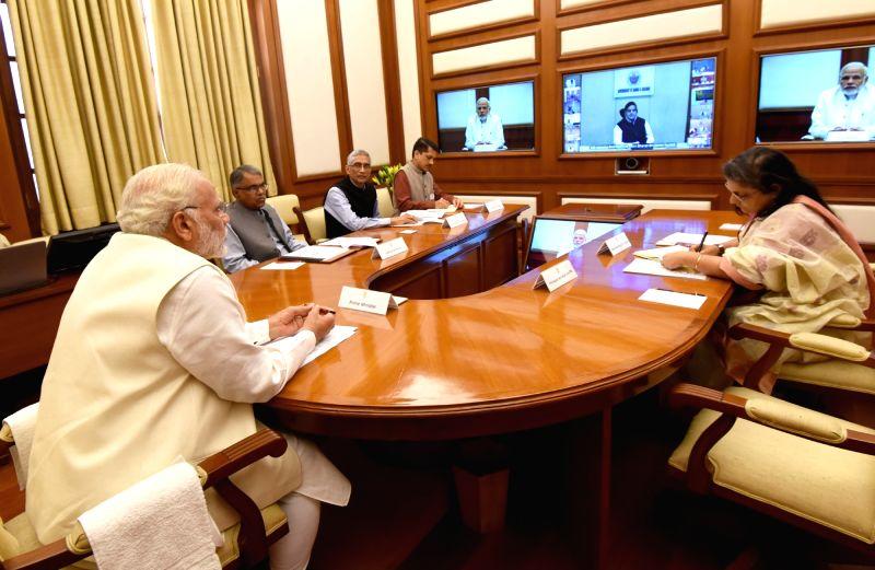 Prime Minister Narendra Modi reviews progress towards ODF (Open Defecation Free) targets in four States - Uttar Pradesh, Bihar, Odisha, and Jammu and Kashmir, in New Delhi on March 13, ... - Narendra Modi