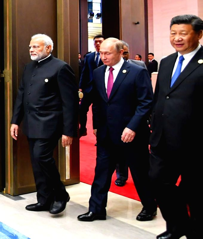 Prime Minister Narendra Modi, Russian President Vladimir Putin and Chinese President Xi Jinping arrive to attend the Restricted Session of the Shanghai Cooperation Organisation (SCO) Summit ... - Narendra Modi