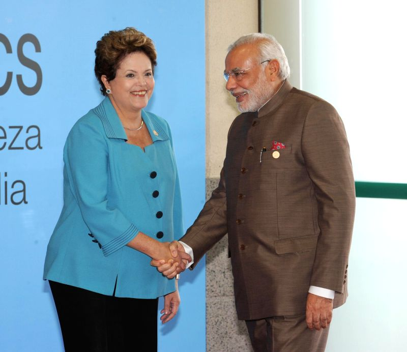 Prime Minister Narendra Modi shakes hands with President of Brazil Dilma Rousseff on his arrival at the Ceara Events Centre for the Sixth BRICS Summit, in Fortaleza, Brazil on July 15, 2014. - Narendra Modi