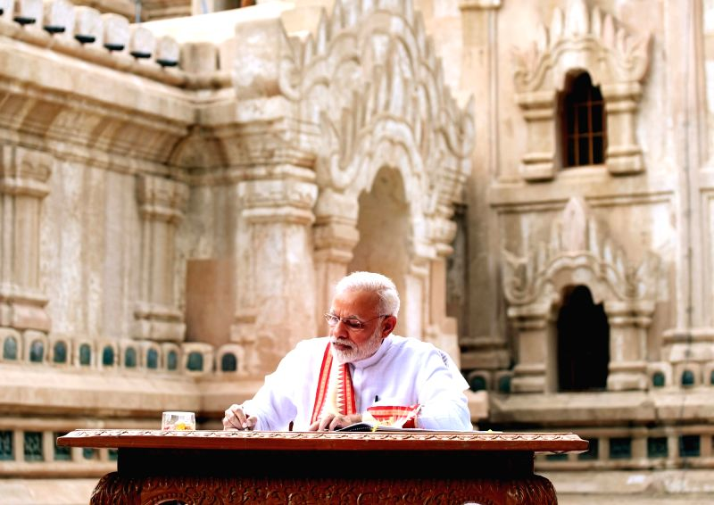Prime Minister Narendra Modi signs the visitors' book at Ananda Temple in Bagan, Myanmar on Sept 6, 2017. - Narendra Modi