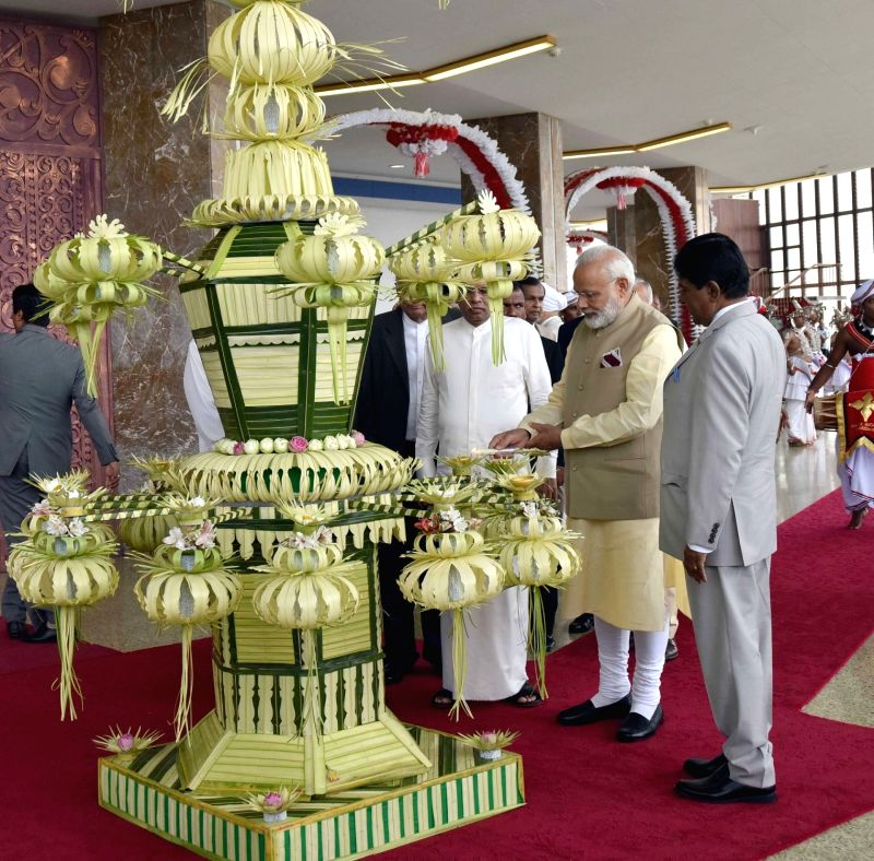 Prime Minister Narendra Modi, Sri Lankan President Maithripala Sirisena and Prime Minister Ranil Wickremesinghe at the inaugural session of the 14th International Vesak Day celebrations in ... - Narendra Modi