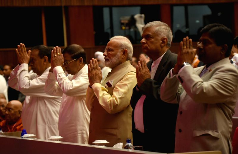 Prime Minister Narendra Modi, Sri Lankan President Maithripala Sirisena and Prime Minister Ranil Wickremesinghe arrive to attend the inaugural session of the 14th International Vesak Day ... - Narendra Modi