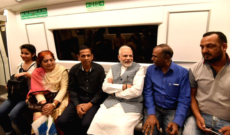 Prime Minister Narendra Modi takes Delhi Metro ride on his way to inaugurate Ambedkar National Memorial at 26 Alipur Road in New Delhi on April 13, 2018. - Narendra Modi