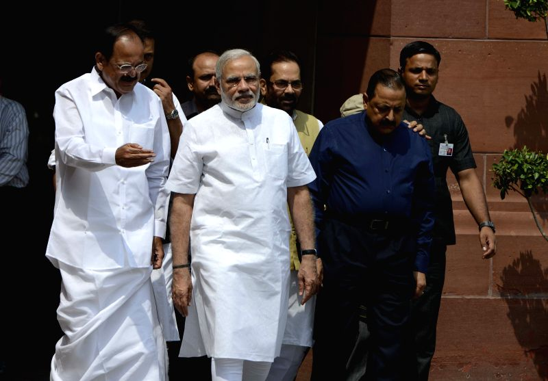 Prime Minister Narendra Modi, the Union Minister for Urban Development, Housing and Urban Poverty Alleviation and Parliamentary Affairs, M. Venkaiah Naidu, Union Minister of State for ... - Narendra Modi, M. Venkaiah Naidu and Rao Inderjit Singh