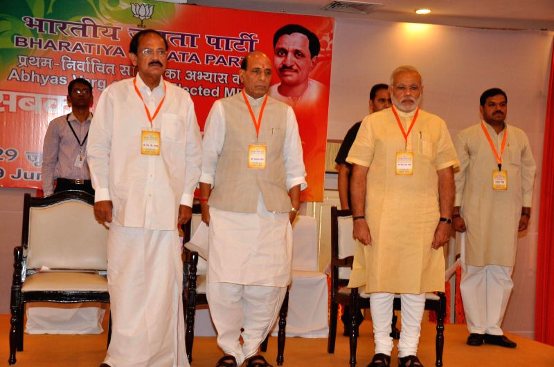 Prime Minister Narendra Modi, Union Home Minister Rajnath Singh and Union Urban Development Minister Venkaiah Naidu at the newly elected BJP MPs workshop at Surajkund in Faridabad on June 28, 2014. - Narendra Modi, Venkaiah Naidu and Rajnath Singh