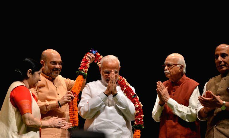 Prime Minister Narendra Modi, Union Home Minister Rajnath Singh and External Affairs Minister Sushma Swaraj with BJP chief Amit Shah and party veteran L. K. Advani during BJP Parliamentary ... - Narendra Modi, Sushma Swaraj, Rajnath Singh, Amit Shah and L. K. Advani