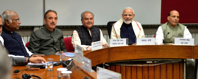 Prime Minister Narendra Modi, Union Ministers Rajnath Singh and Narendra Singh Tomar and Congress MPs Ghulam Nabi Azad and Mallikarjun Kharge during an all party meeting ahead of the ...