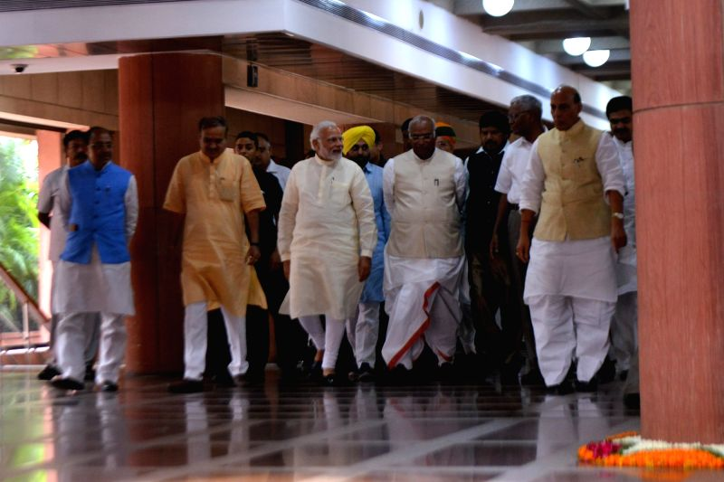 Prime Minister Narendra Modi, Union Ministers and BJP leaders Vijay Goel, Ananth Kumar and Rajnath Singh, Congress leader Mallikarjun Kharge and CPI leader D. Raja arrive to attend an ... - Narendra Modi, Ananth Kumar and Rajnath Singh