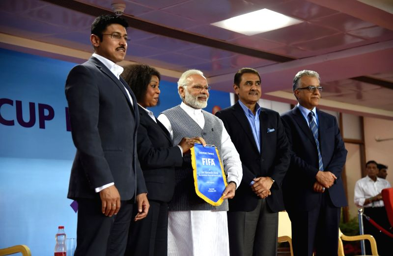 Prime Minister Narendra Modi, Union Sports Minister Col. Rajyavardhan Singh Rathore, AIFF president Praful Patel  with other dignitaries ahead of the FIFA U-17 World Cup 2017 Group A match ... - Narendra Modi, Rajyavardhan Singh Rathore and Praful Patel