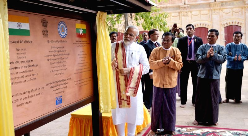 Prime Minister Narendra Modi unveils a plaque signifying the contribution of India in the restoration of the Ananda Temple in Bagan, Myanmar on Sept 6, 2017. - Narendra Modi