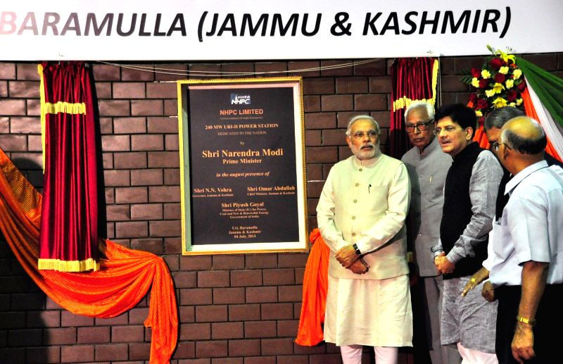 Prime Minister Narendra Modi unveils the plaque as he dedicates 240 MW Uri-II hydro-power project to the nation at Uri in Baramulla district of Jammu and Kashmir on July 4, 2014. Also seen MoS ... - Narendra Modi
