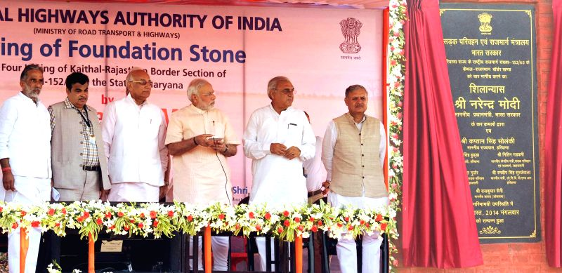 Prime Minister Narendra Modi unveils the plaque to lay the Foundation Stone for the four-laning of ``Kaithal-Narwana-Hisar-Rajasthan Border`` Highway, at Kaithal, in Haryana on August 19, 2014. Also . - Narendra Modi, Kaptan Singh Solanki and Rao Inderjit Singh