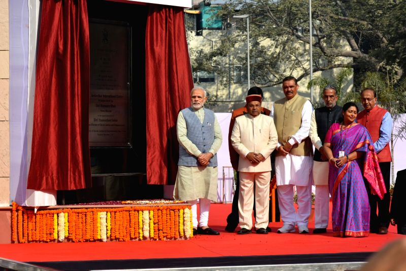 Prime Minister Narendra Modi unveils the plaque to dedicate Dr. Ambedkar International Centre to the Nation in New Delhi on Dec 7, 2017. Also seen Union Ministers Thaawar Chand Gehlot, ... - Narendra Modi, Thaawar Chand Gehlot, Vijay Sampla, Krishan Pal and Vijay Goel